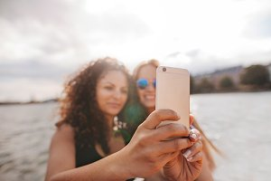 Women taking selfie with smart phone