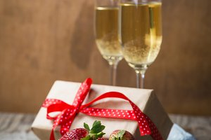 Valentine's day concept - champagne, strawberry and present