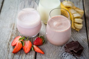 Selection of flavoured milk - strawberry, chocolate, banana