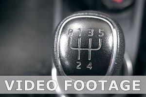 Gear stick inside modern car going out of focus