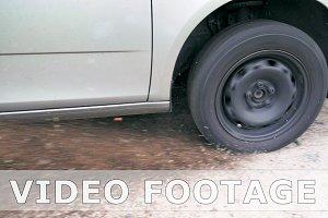 Car wheel skidding on ground