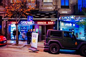 Portu street cafe at night