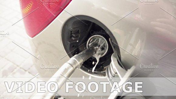 Petrol Pump Filling Fuel Into A Car At Gas Station