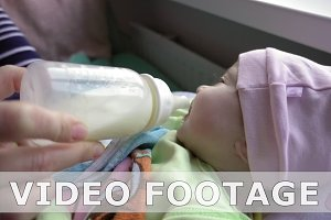 Newborn baby feeding from baby bottle