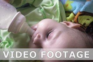 Newborn baby feeding from baby bottle