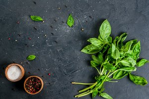 Kitchen table with spices & basil