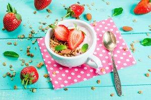 Yogurt with granola and strawberry