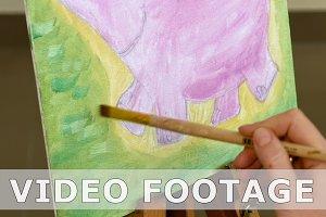 Artist paints picture artwork in art studio