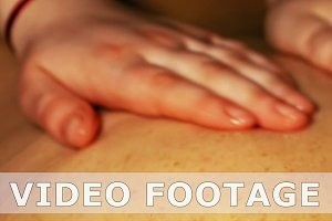 Woman gets four hands oil massage on her back