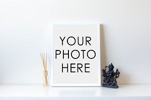 White Frame With Statue and Diffuser
