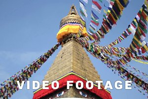 Colored flags fly near Boudha Bouddhanath or Baudhanath stupa in Nepal