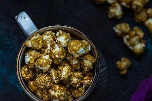 Homemade Golden Caramel Popcorn in a cup