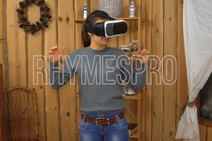 Young brunette woman using vr glasses at home