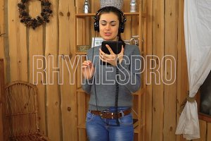 Young brunette girl with headphones listening music from tablet