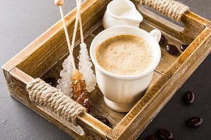 Cup of coffee in vintage wooden tray