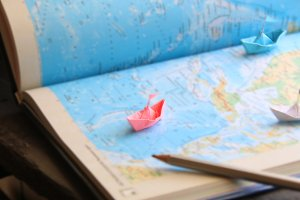 journey idea or planning vacation trip with map, blurred photo for background