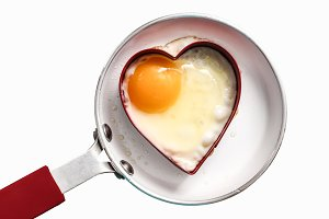 Fry pan with egg in heart shape