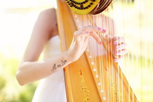 girl playing harp