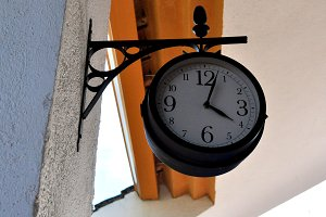 Station clock hanging on wall