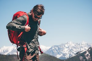 Man Traveler wearing backpack hiking