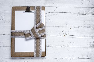 Clipboard with tie