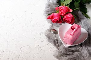 Pink cake and roses on white background, girl party. Free space for your text.