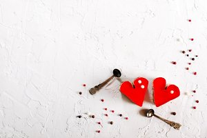 Two jelly heart-shaped cakes on white concrete background. Free space for your text.