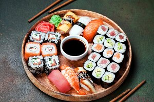 Sushi set nigiri and rolls served in round plate