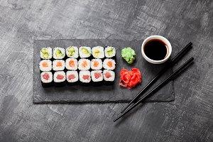 Sushi rolls served on stone slate