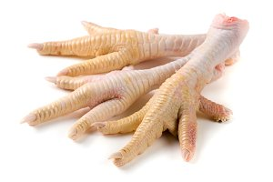 Three chicken feet isolated on white background