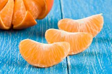 tangerine slices on a blue wooden background