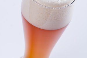 Beer glass over white