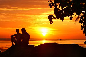 couple silhouette on sunset background