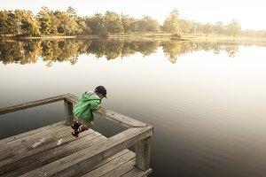 Child Playing at Lake
