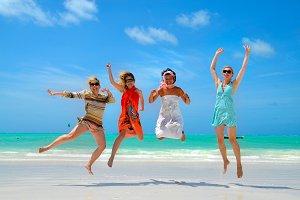 Girls Jumping on a Tropical Beach