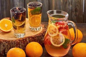 Summer fruit drink on wooden background