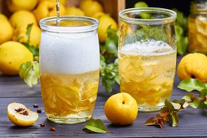 carbonated drink with syrup of japanese quince on fresh  fruits background