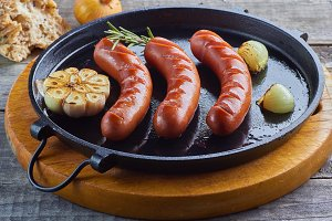 Grilled sausages with garlic and onion