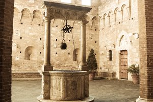 Ancient water well in a italian city