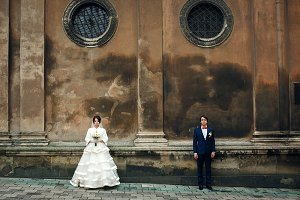 Newlyweds under an old cathedral