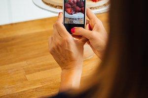 Woman takes photo of pie