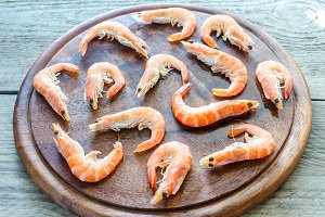 Raw shrimps on the wooden board
