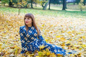 beautiful girl in park autumn