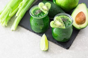 Blended green smoothie with ingredients. Superfood, detox and he