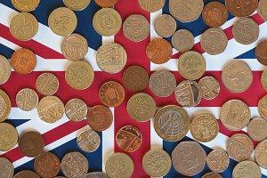 Pound coins, United Kingdom over flag