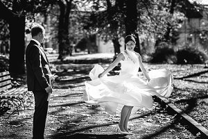 Beautiful bride whirls in the park