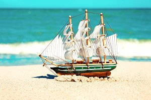 Model of ship in the sand.