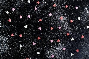 dark background with sugar hearts
