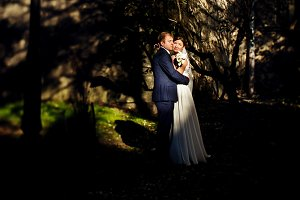 Stunning newlyweds hug