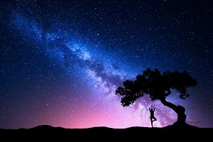 Milky Way with old tree and woman